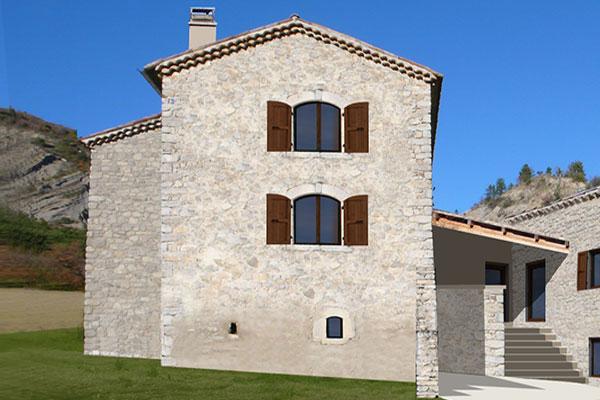 architecture: transformation d'une ferme en habitation en pierre apparente et materiaux ecologiques